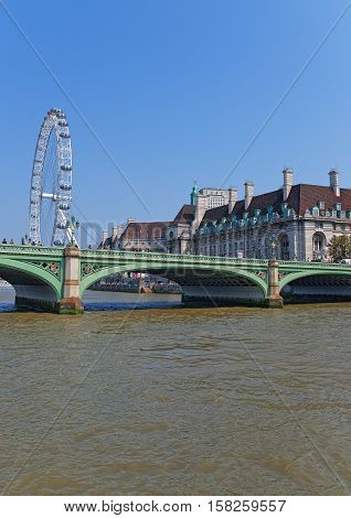 Westminster Bridge London Eye And County Hall On River Thames
