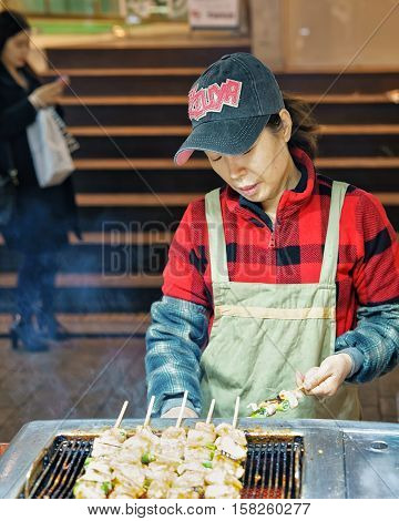 Woman Seller Of Kebab Skewers At Myeongdong Street Market Seoul