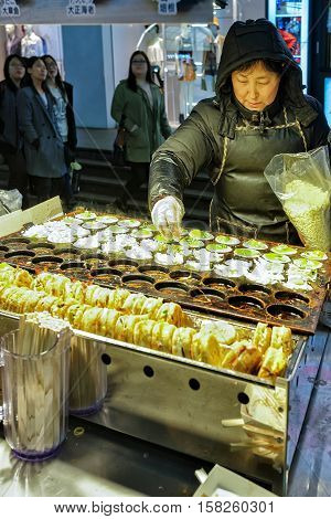 Woman Selling Food At Myeongdong Open Street Market In Seoul