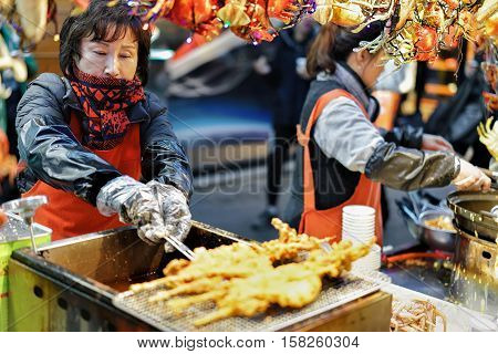 Woman Sellers Of Seafood At Myeongdong Open Street Market In Seoul