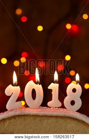 2018 Candles Burning On Top Of A Cake