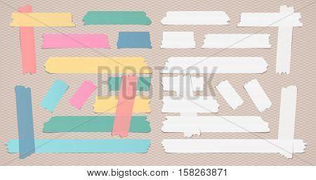 Colorful and white different size sticky, adhesive masking tape are on brown background.