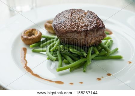 Delicious sirloin steak with green beans and mushrooms