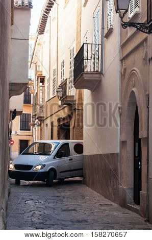 Car in the narrow streets of the old Majorca city Spain