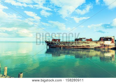 Disused and wasting away wooden barge in the Firth of Thames at Miranda New Zealand