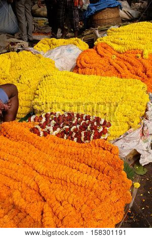 KOLKATA, INDIA - FEBRUARY 10: Flowers and garlands for sale at the flower market in the shadow of the Haora Bridge in Kolkata on February 10, 2016.