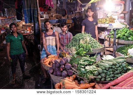 KOLKATA, INDIA - FEBRUARY 11: Farmer sell vegetables in New Market in Kolkata on February 11, 2016.
