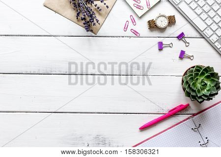 female wooden desktop with flowers top view no one