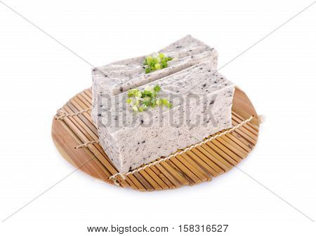 tofu mix black sesame seeds on bamboo mat with white background