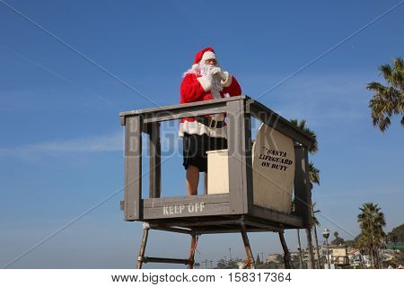 Santa Claus Lifeguard. Santa Life Guard. Santa Claus is a Life Guard at the beach.