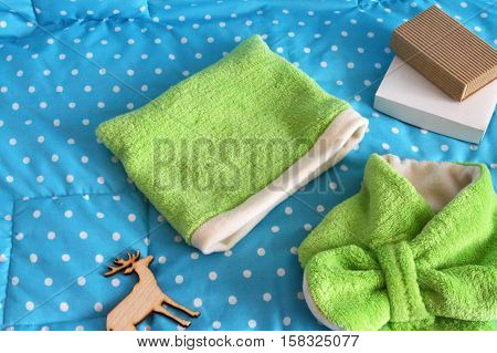 stitched stuffed blanket for babies on a wood background