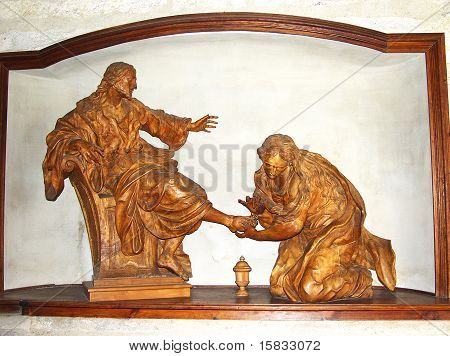 Washing the feet. Church sculptures