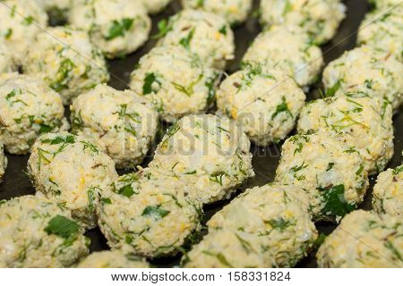Fresh vegetarian falafel balls, traditional oriental Middle Eastern meal dish.