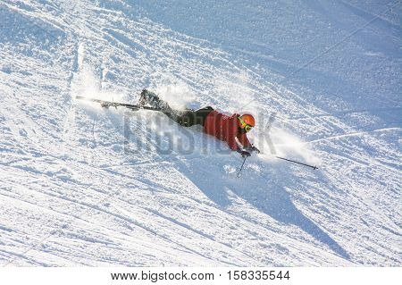 TERMINILLO ITALY - JANUARY 02 2015: Skier falling on the of Ski resort Terminillo mountains Apennines central Italy. This is the most important ski resort of the Lazio.