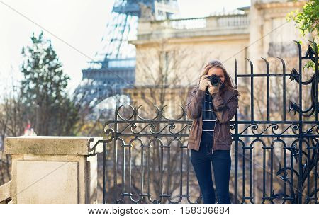Young Girl Taking A Street Photo In Paris