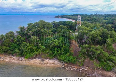 Labuan,Malaysia-Nov 24,2016:Aerial view of the lighthouse on top of the Tanjung Kubong hill in Labuan island,Malaysia.The lighthouse is basically a steel frame tower.