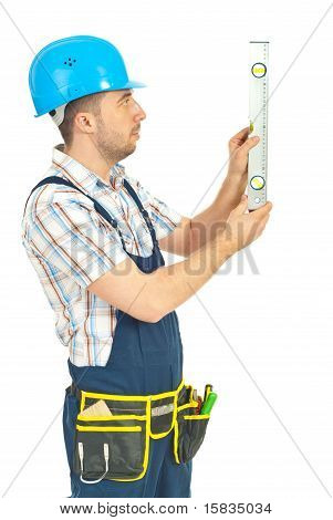 Worker Man Measuring With Bubble Level