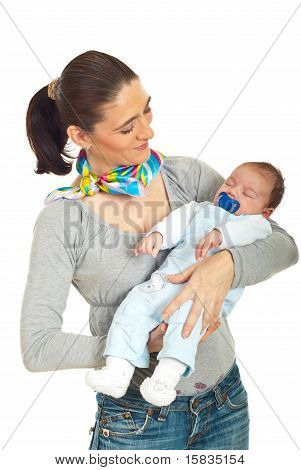 Mother Holding Sleeping Newborn Baby