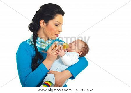 Mother Attentive To Newborn Drink