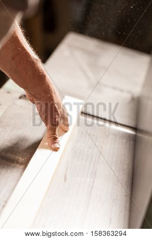 Hands Shaving A Plank On A Surface Planner