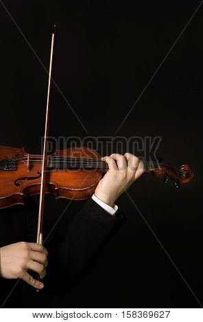 Performer Hands Playing the Violin, Isolated on Black