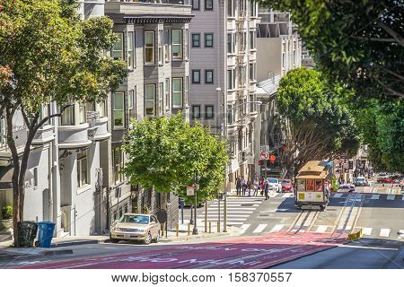 San Francisco, California, United States - August 17, 2016: The steep Powell Street, the most famous and tourist tram line of San Francisco in a sunny day. A Cable Car on background.
