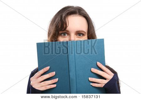 Woman Looks Up From Reading A Hard Cover Book