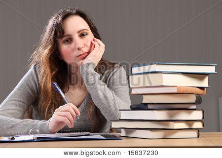 Tired Student Girl Sitting To Desk Doing Homework