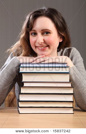 Beautiful Happy Student Sitting With Study Books