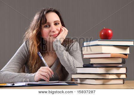 Happy Student Girl Doing Homework With Books