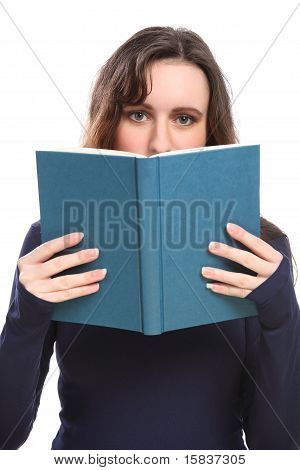 Young Woman Reading Holding Book Up To Her Face