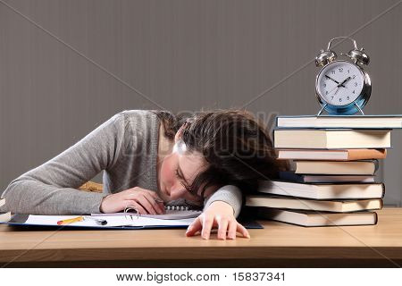 Student Falls Asleep Doing Homework Late At Night