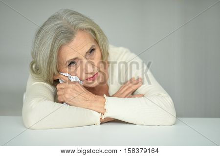 Portrait  of thoughtful senior woman with handkerchief