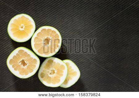 Grapefruit Sweetie On A Concrete Gray Background. The Concept Of Healthy Nutrition And Diet.