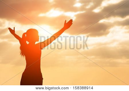 silhouette of woman pray with sunlight, asian