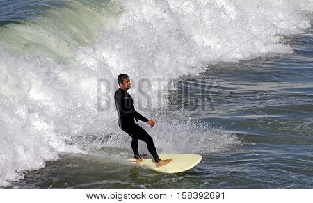 SAN DIEGO, CALIFORNIA - NOVEMBER 08:Unknown surfer on the board at La Jolla on November 08,2016 in San Diego, California, USA.