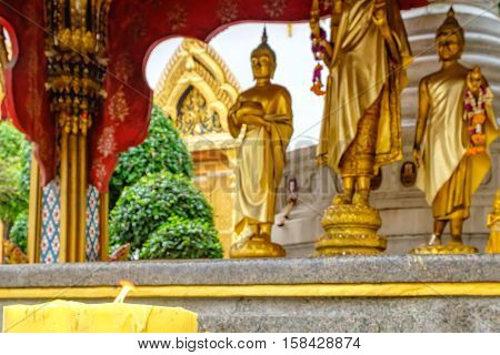 Decoration and Gold Buddha Statue in Buddhist temple Wat Chana Songkhram. It is located near popular street Khaosan road and district for tourists. Selective focus on candle
