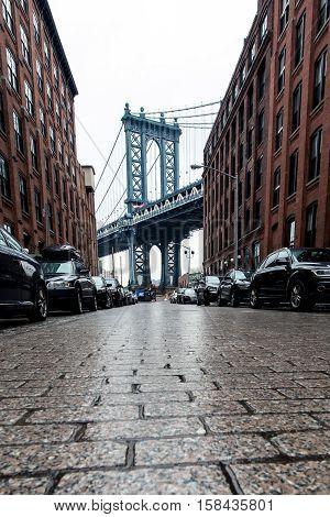 Cobblestone street in Brooklyn with Manhattan Bridge in background