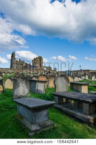 Whitby England - May 11 2011: Whitby Churchyard and Cemetery North Yorkshire in the UK. It is ruins of the Benedictine abbey. Now it is under protection of the English Heritage.