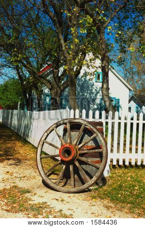 Wagon Wheel And White Picket Fence