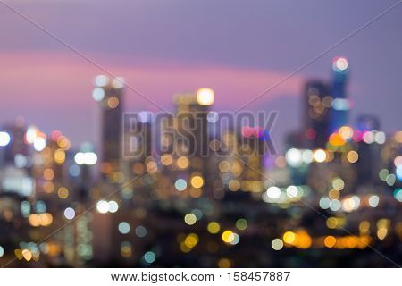 Blurred lights city office building downtown with after sunset sky background