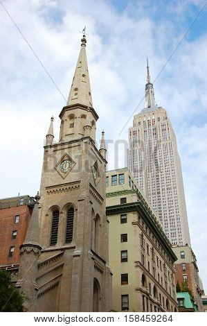 NEW YORK CITY - OCT 3, 2011: Marble Collegiate Church and Empire State Building on Fifth Avenue in midtown New York City, USA.