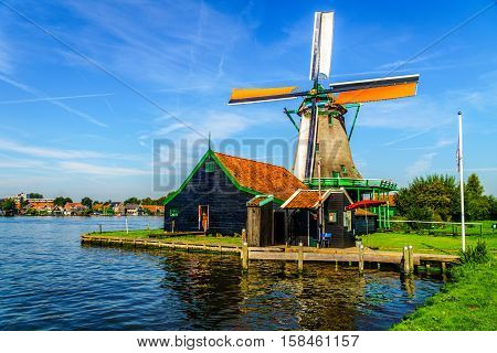 Fully Operational Historic Dutch Windmill in Zaanse Schans and the Zaan River in the Netherlands