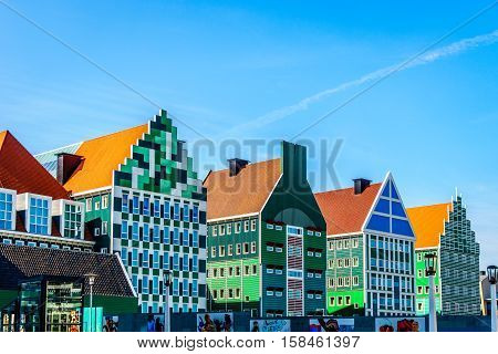 Modern High Rise Building incorporating Blue and Green Colored traditional Zaanse Gabels in Zaandam in the Netherlands