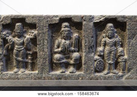 KOLKATA, INDIA - FEBRUARY 09, 2016:  Lintel: Surya, Siva Lakulisa and Vishnu, 26th regnal year of Dharmapala, ca. 770-810 C.E. found in Bodhgaya, Bihar now exposed in the Indian Museum Kolkata, India