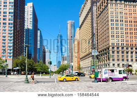 NEW YORK,USA - AUGUST 22,2016 : Street scene in downtown Manhattan with the One World Trade Center tower on the background