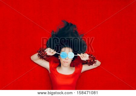 Funny Christmas Girl Holding Lollipops on Red Background