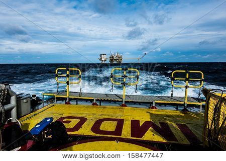 oil and gas industry and moving cargo from the boat to the platform, boat waiting transfer cargo and crews between oil and gas platform and crews boat operation in boat.