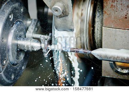 metalworking industry. polishing metal surface on grinder machine