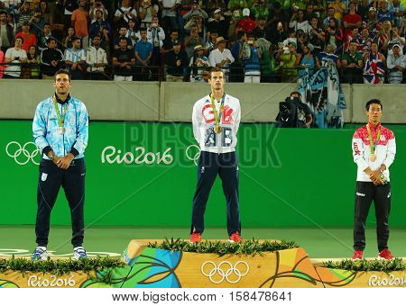 RIO DE JANEIRO, BRAZIL - AUGUST 14, 2016:Juan Martin Del Porto ARG (L), Olympic champion Andy Murray GBR and Kei Nishikori JPN during tennis men's singles medal ceremony of the Rio 2016 Olympic Games